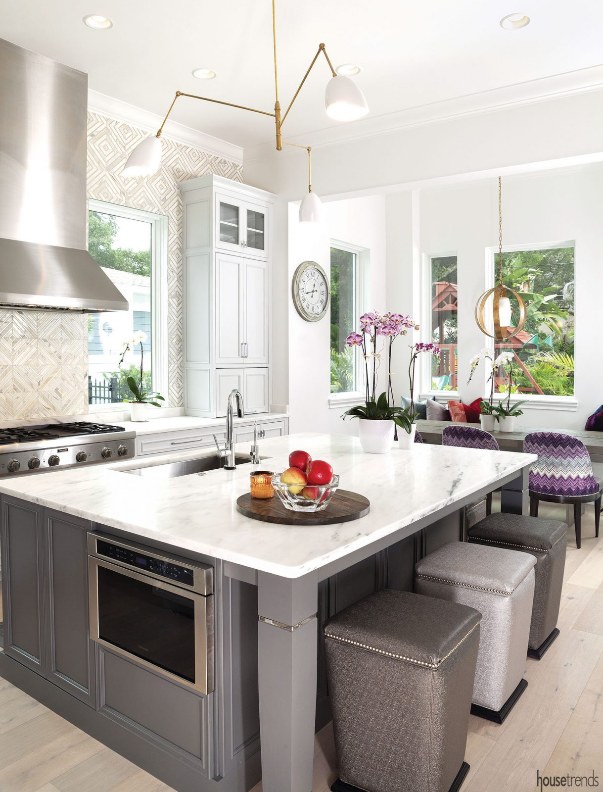 Kitchen island topped with Calacatta marble