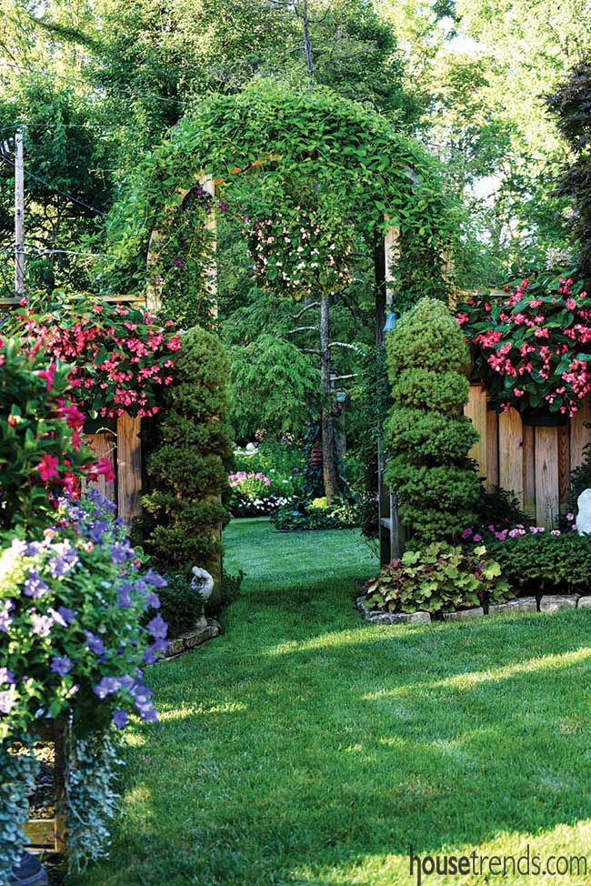 Colorful plants soften an arbor