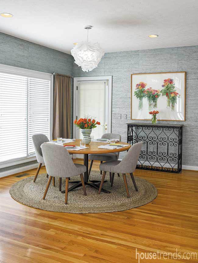 Eating area boasts grasscloth wallpaper