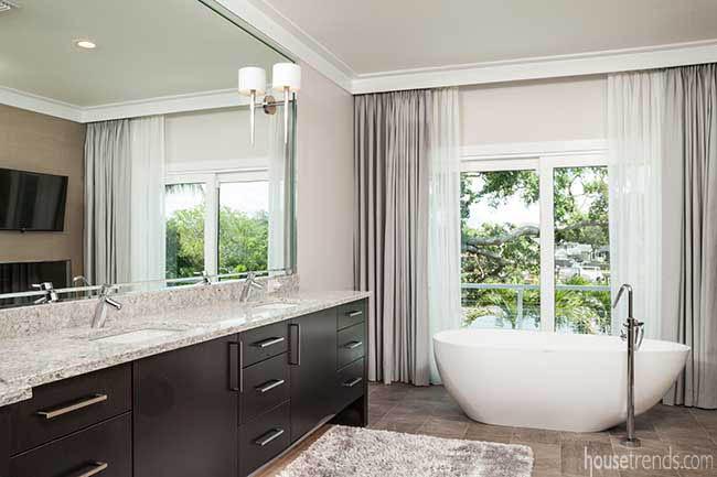 Freestanding soaking tub in a master bathroom