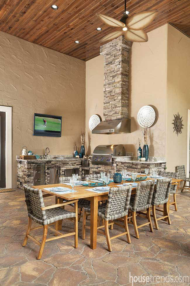 Covered area boasts a full outdoor kitchen