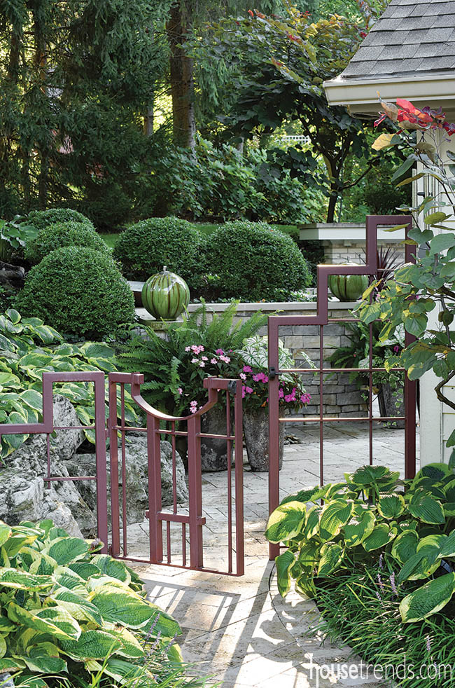 Steel gate with copper coloring adds elegance to a yard