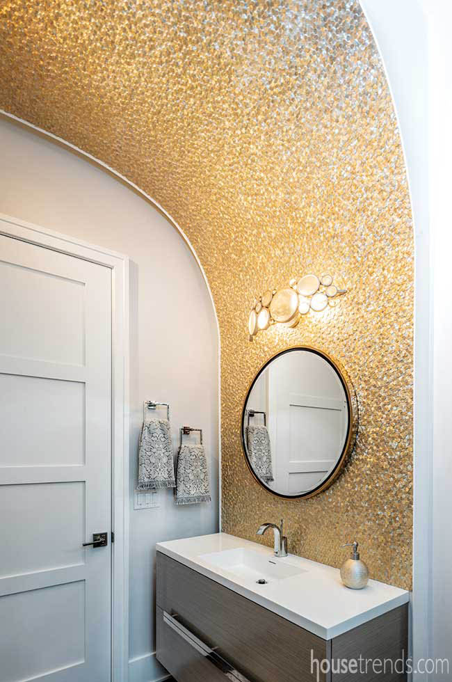 Gold tile dazzles in a powder room