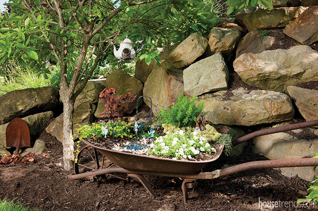 Fairy garden accessories add whimsy to a back yard