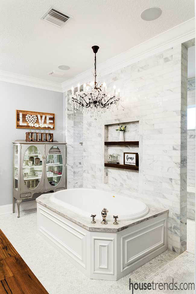 Chandelier shines on a luxurious master bath