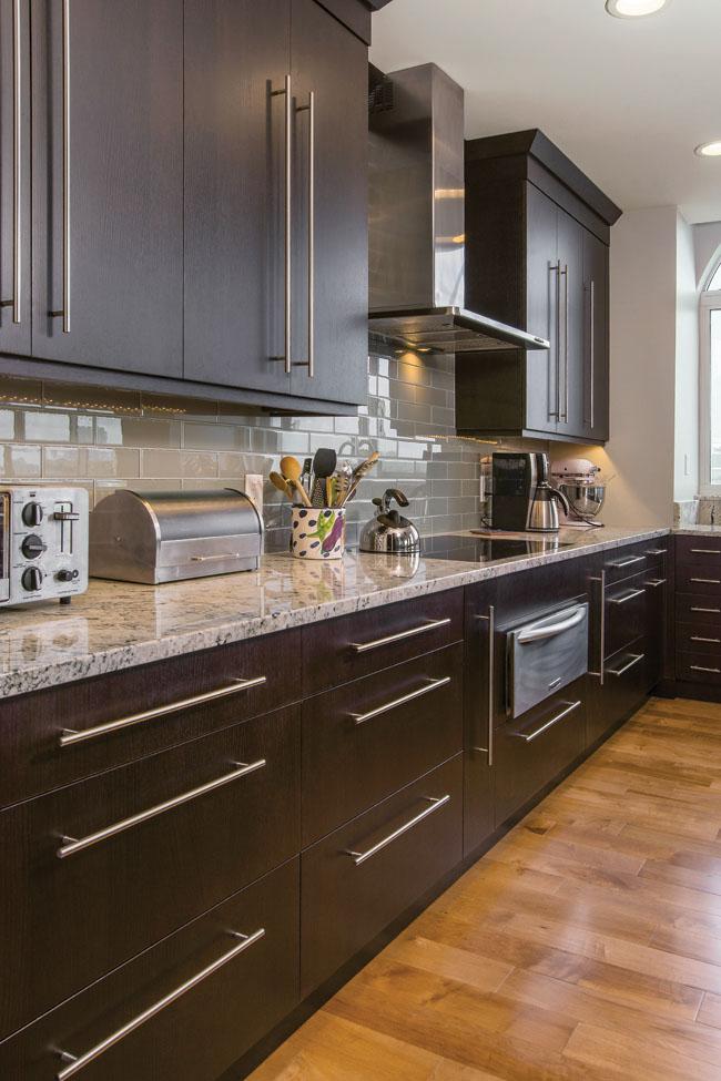 Dark oak cabinets add a touch of drama