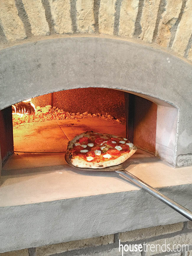 Kitchen design puts all focus on wood-fired pizza oven