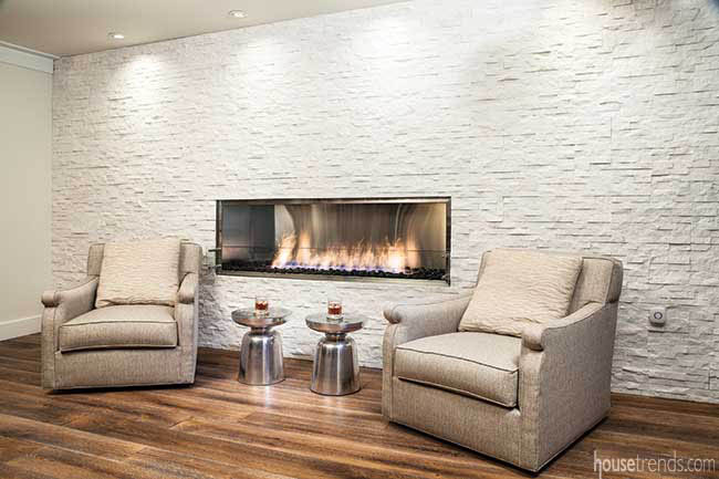 Linear fireplace adds a cozy touch to a sitting area