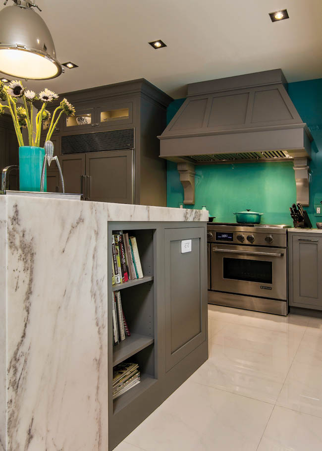 Kitchen island features a mesmerizing waterfall countertop