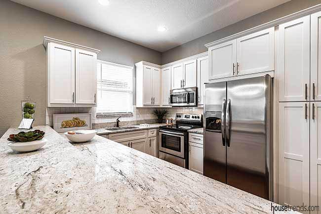 Granite countertops complement the kitchen