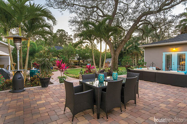 Paver patio hosts an outdoor dining area