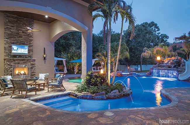 Swimming pool leads to a covered outdoor area