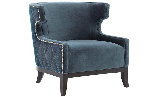 Nailhead trim adds a little sparkle to a blue chair
