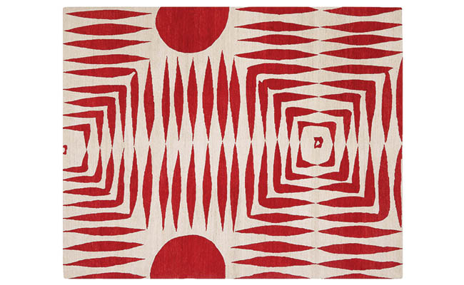 Red rug with a symmetrical pattern