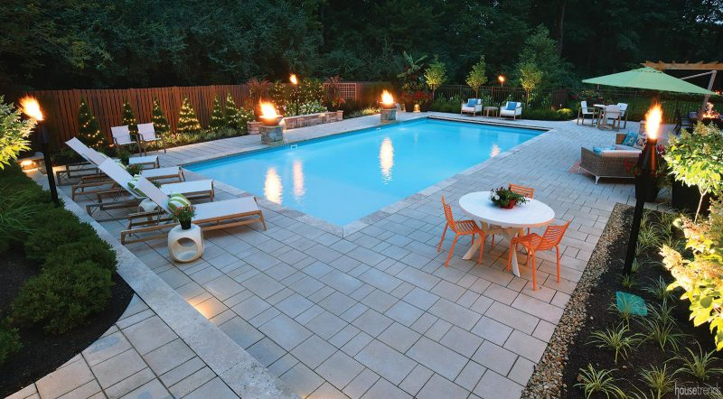 Privacy fence surrounds a back yard pool