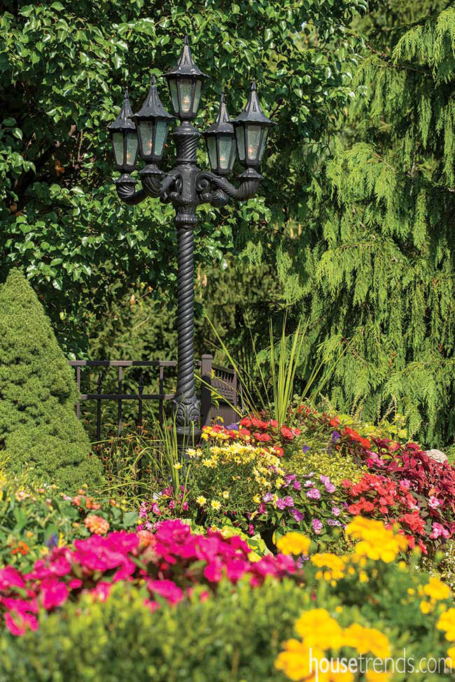 Outdoor lighting spotlights colorful blooms