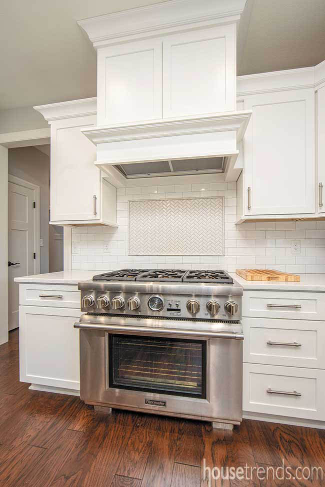 Oven draws attention in a white kitchen