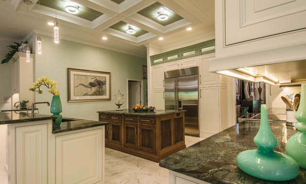 Kitchen remodel uses wall sconces in an unusual place