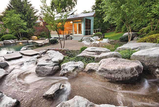 Boulders interrupt a back yard stream