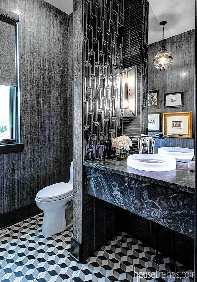 Dramatic black powder room wows guests