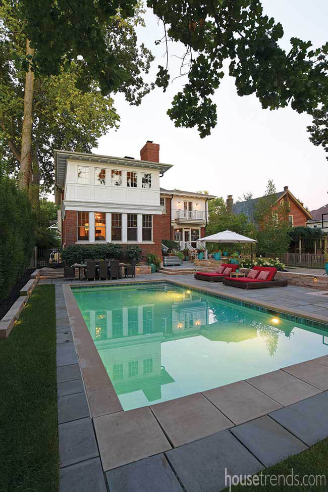 Swimming pool dominates a remodeled back yard