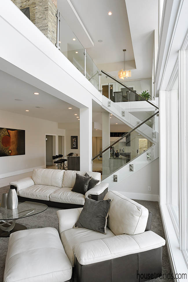 Glass staircase railing blends two levels