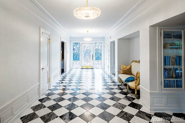 Marble flooring welcomes guests to an entry hall