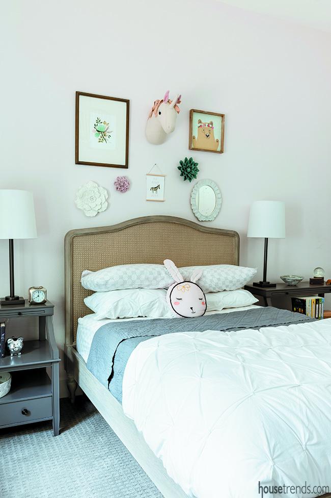 Cozy bedroom design includes a fabric headboard