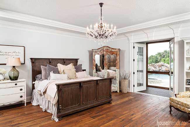 Master bedroom features wide plank flooring