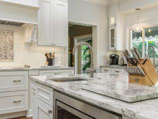 Kitchen island houses convenient appliances