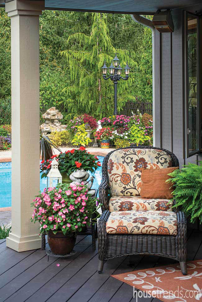 Potted plants surround outdoor furniture