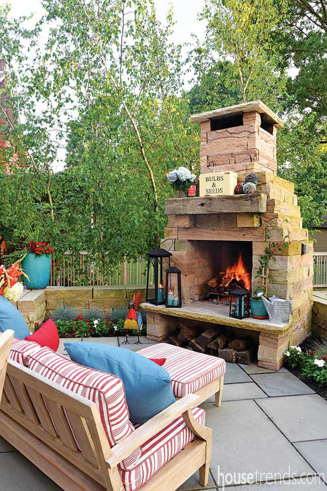 Cozy furniture in front of an outdoor fireplace