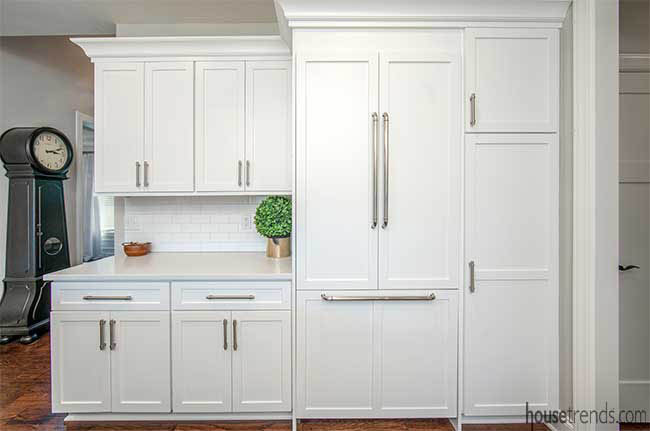 White cabinetry hides a refrigerator