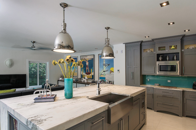 Light fixtures shine on a waterfall countertop