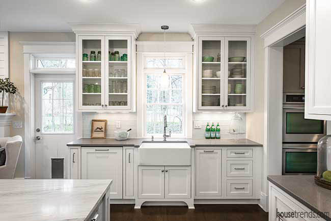 Kitchen appliances hidden by cabinetry