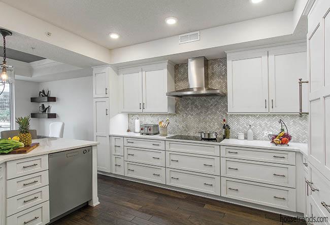Mosaic tile backsplash complements kitchen appliances