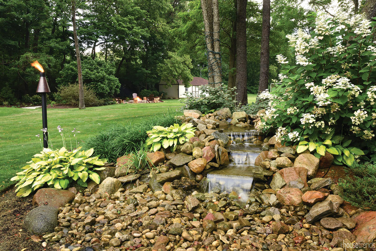 Back yard waterfall creates a soothing ambiance