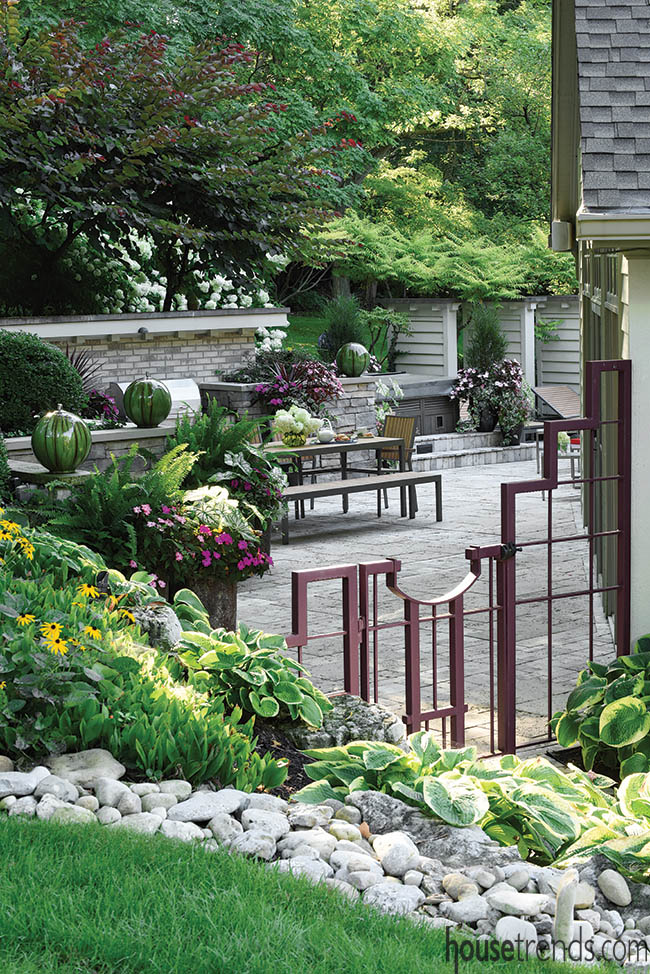 Travertine paver patio anchors a back yard