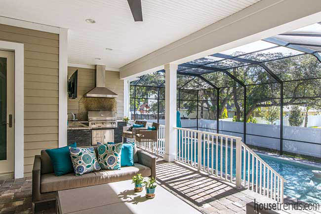 Outdoor kitchen overlooks a pool