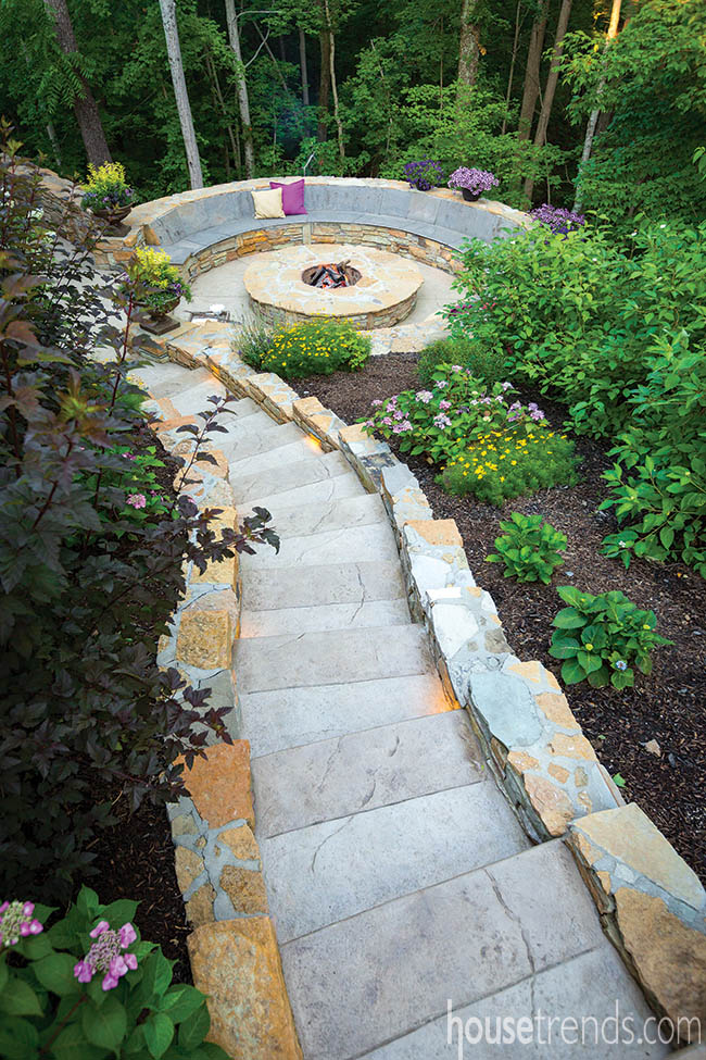Stone steps lead to a fire pit