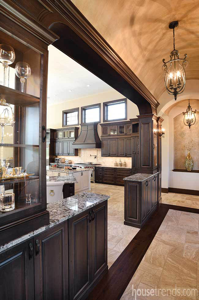 Custom cabinetry stained to match wood molding