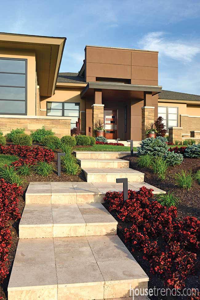 Colorful begonias soften a contemporary facade