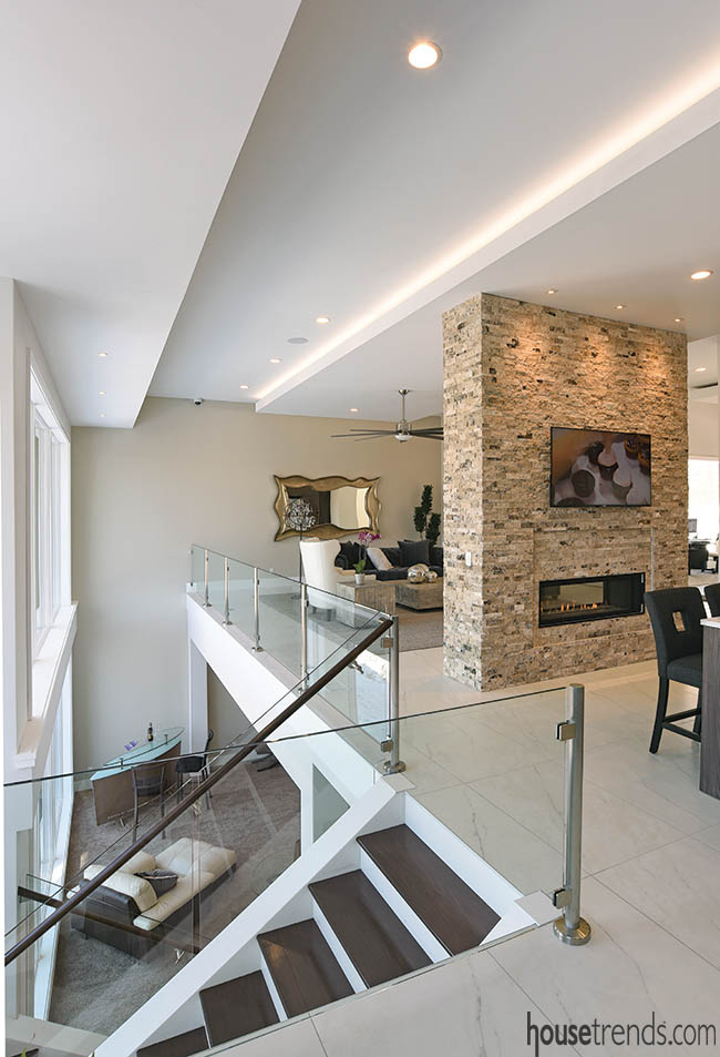 Glass railing offers glimpse of a lower level