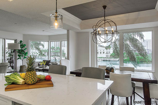 Orbit light fixture lights up a dining area