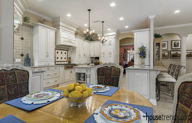 Furniture lends dark color to a kitchen