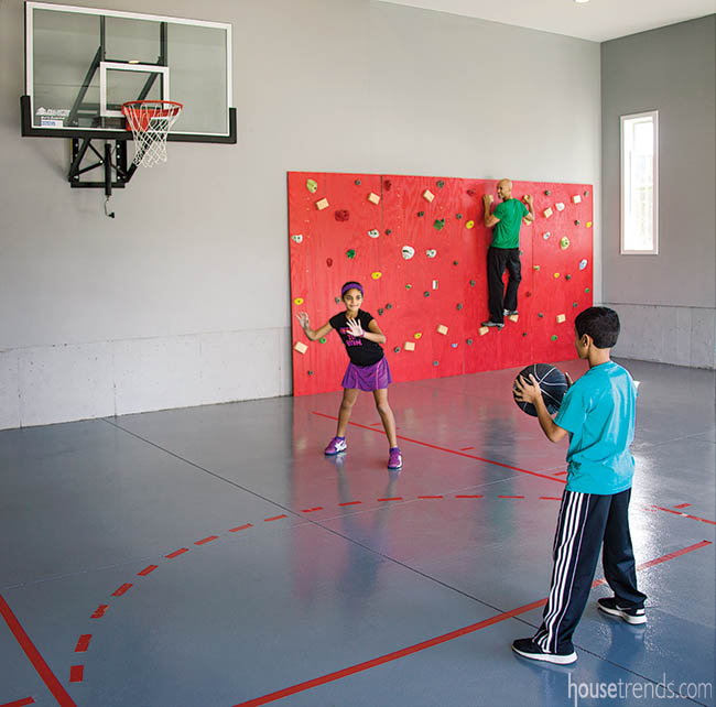 Heated garage boasts a basketball court and climbing wall