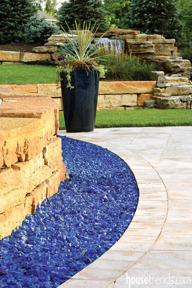 Blue glass mulch adds color to a back yard