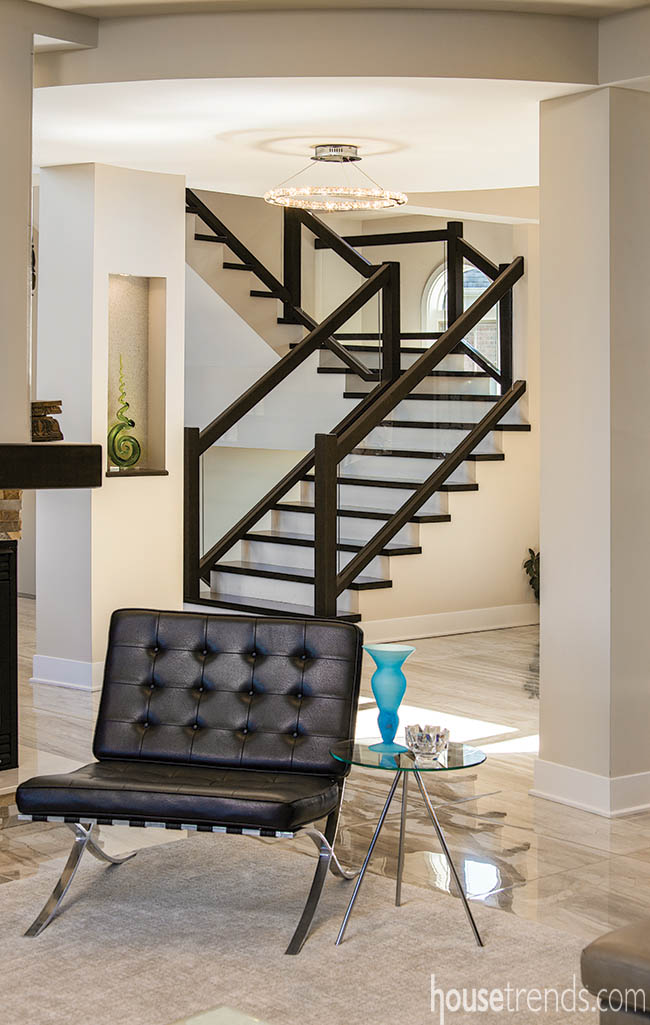 Glass-paneled staircase lends a contemporary vibe