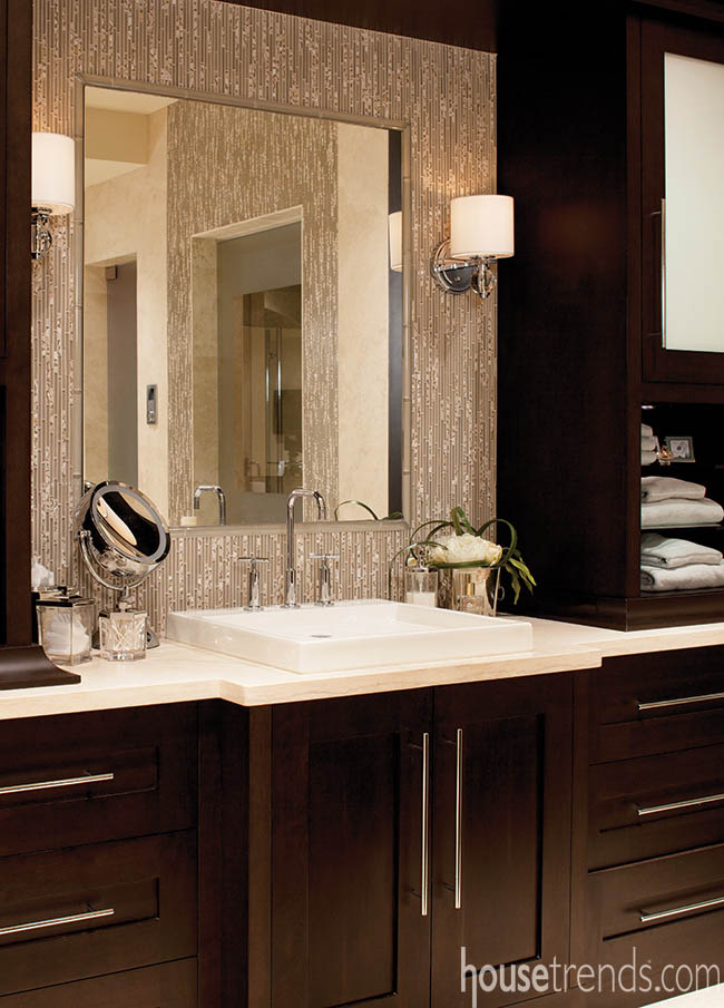 Vanities pop with dark cabinetry