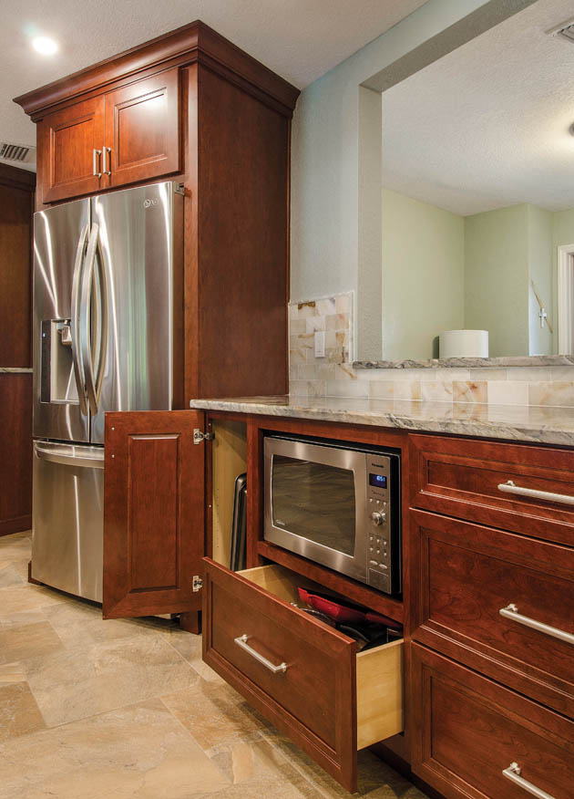 Door knobs and other hardware help to pull the kitchen design together